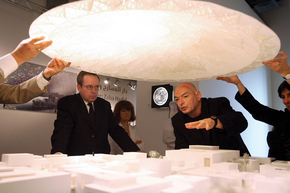 Jean Nouvel explains the museum with the dome lifted off