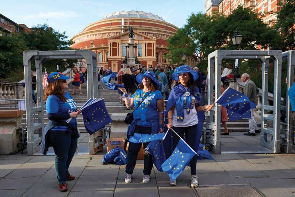Pro-EU demonstrators activists hand out EU flags to concert goers outside the Royal Albert Hall in London on September 9, 2017 ahead of the Last Night of the Proms concert