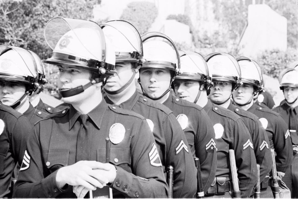 A photo by Raul Ruiz showing LAPD officers at Los Angeles Civic Center demonstration, around 1970