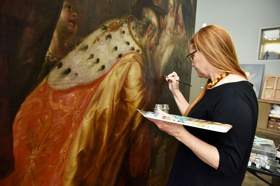 Conservator Dorothy Mahon works on the painting at the Met