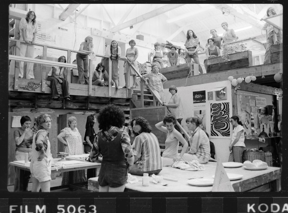Judy Chicago addresses a gathering of volunteers in the Dinner Party studio, around 1978