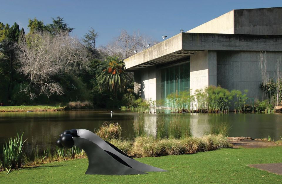 The gardens of the Museu Calouste Gulbenkian with a sculpture by Rui Chafes from his exhibition The Weight of Paradise