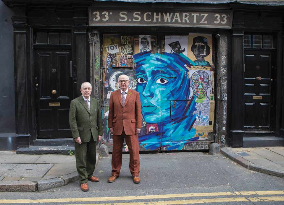 Gilbert & George with some graffiti on Fournier Street