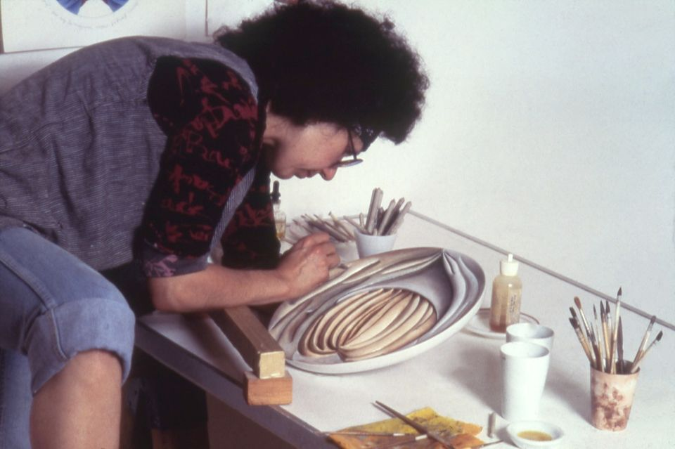 Judy Chicago working on Hrosvitha Test plate #3, 1975-1978