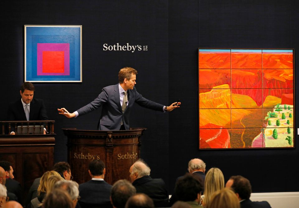 Josef Albers's Homage to the Square Temperate (1957), on the left, during Sotheby's auction on 5 October in London