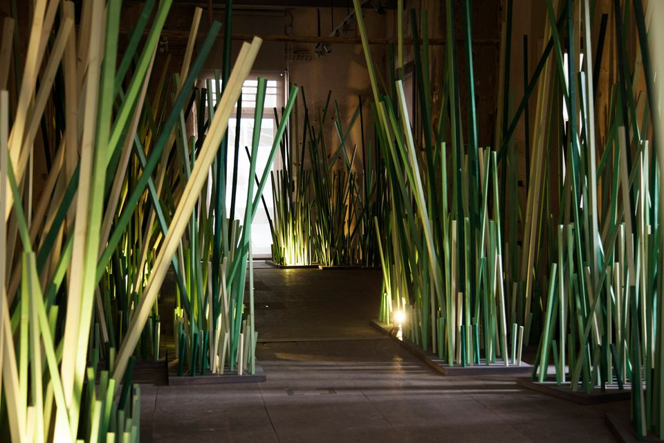 "Zena el Khalil's ""forest"" of 17,000 green sticks planted through the top two floors of the Museum of Memory in Beirut"