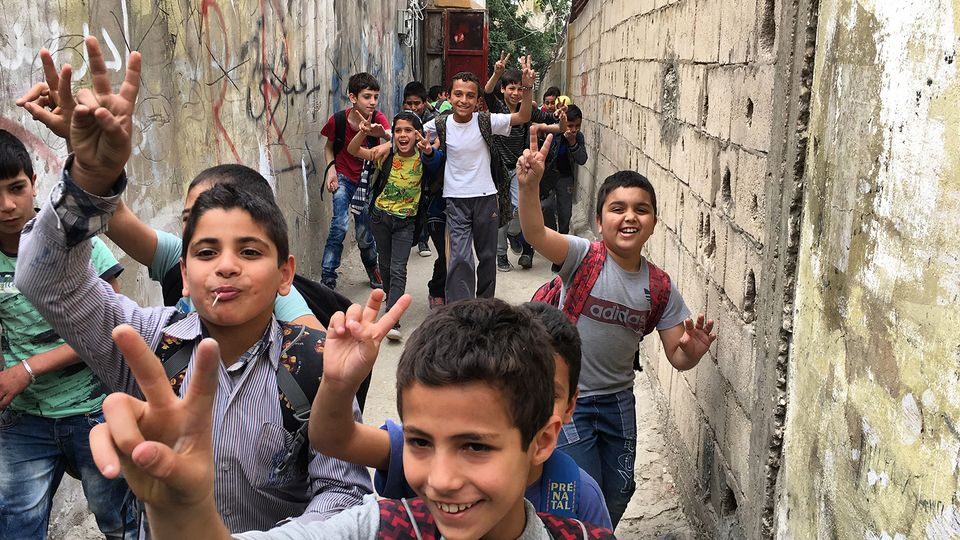 A group of children run through Ain al-Hilweh, the largest Palestinian refugee camp in Lebanon, from Human Flow by Ai Weiwei