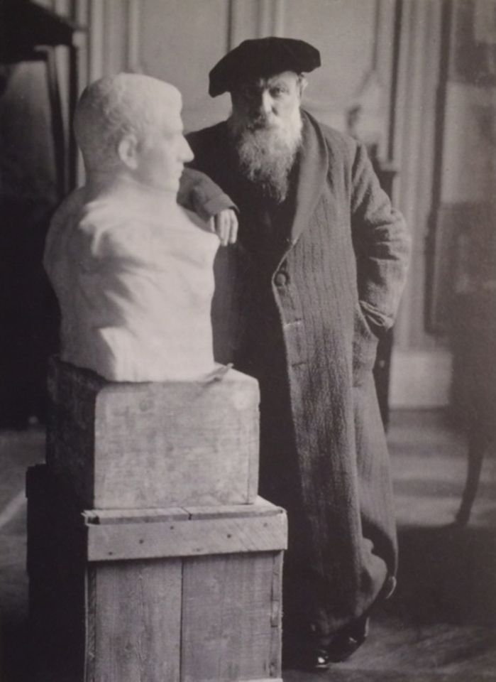 A photograph from 1910 shows Rodin posing next to his bust of Napoleon