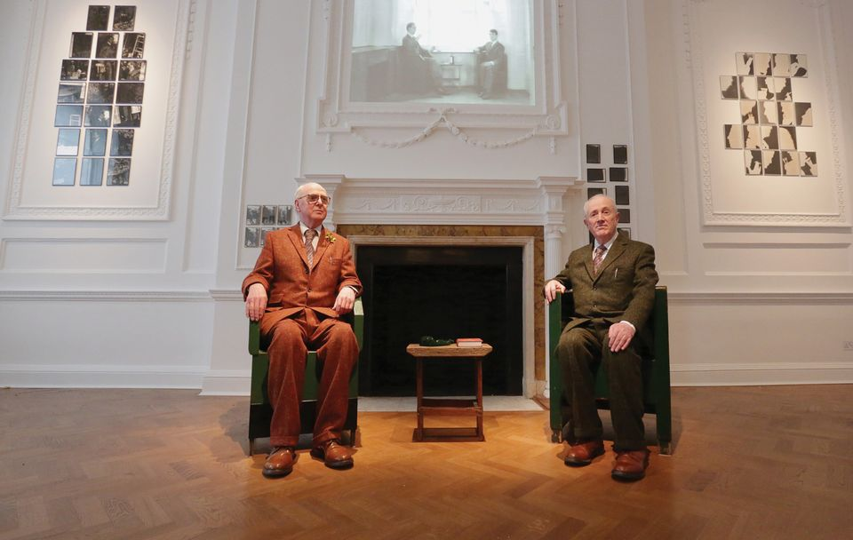 Gilbert and George in front of their video Gordon's Makes Us Drunk (1972) and the Drinking Pieces Twelve Noon (1973) and Toy Wine (1972), featured in the exhibition Gilbert & George: Drinking Pieces & Video Sculpture 1972-73 at Galerie Thaddaeus Ropac, London.