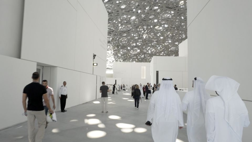 Visitors inside the newly opened  Louvre Abu Dhabi