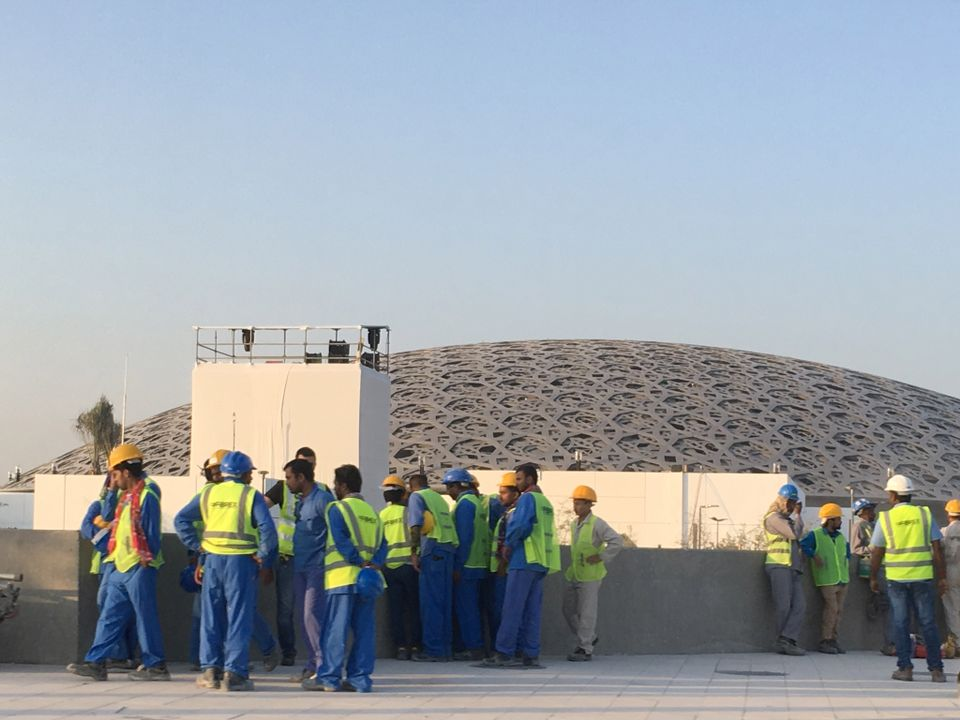 Workers at the Louvre Abu Dhabi