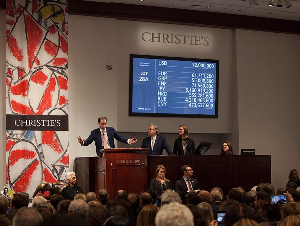 Auctioneer Adrien Meyer hammers down the winning bid on the Van Gogh