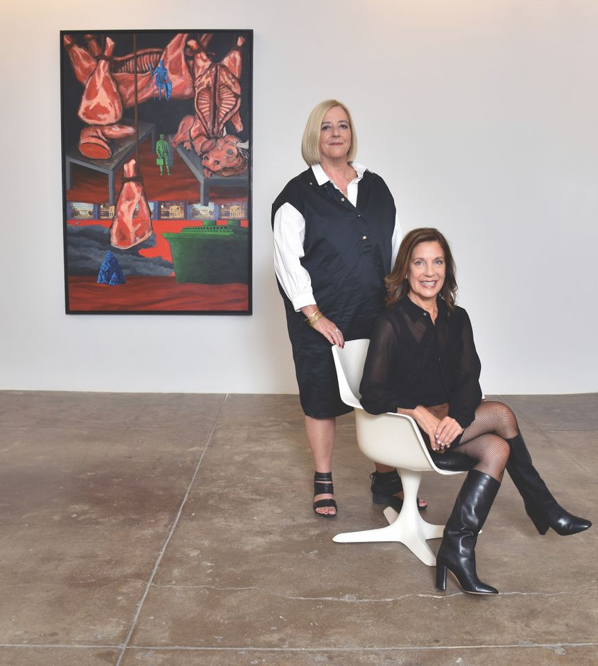 Portrait of Penny Pilkington and Wendy Olsoff (in background is artwork by David Wojnarowicz, North/South: The New Legionnaires, 1986) at 535 West 22nd Street, New York, 2017