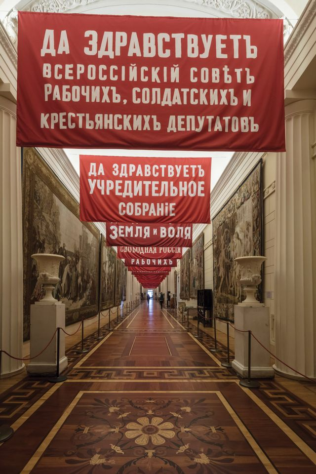 The Hermitage's director, Mikhail Piotrovsky, says he has received hate mail about the revolutionary banners hanging in the former palace of the tsars