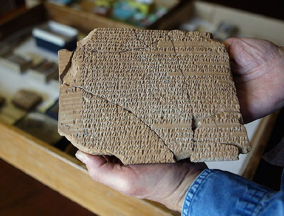 Matt Stolper, director of the Persepolis Fortification Archive at the University of Chicago's Oriental Institute, holds a large tablet with cuneiform text