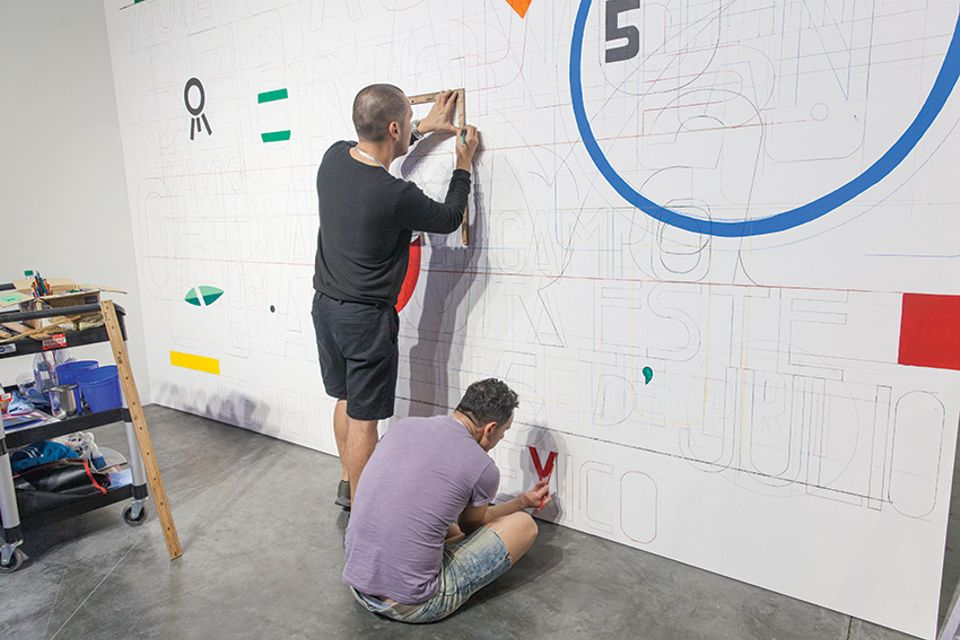 Tercerunquinto working on their mural at Proyectos Monclova's stand during Art Basel Miami Beach 2017