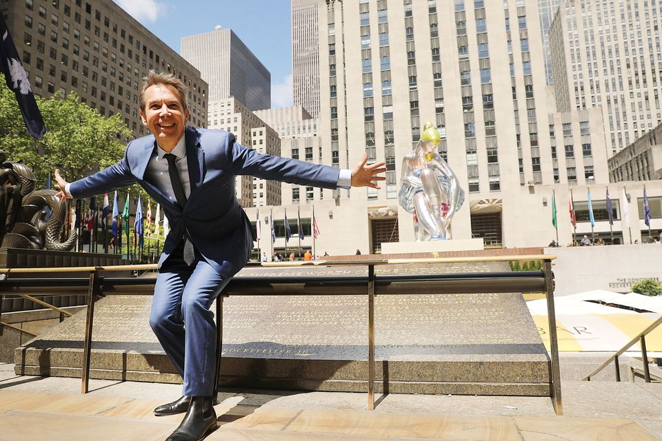 Artist Jeff Koons poses in Rockefeller Center in front of Seated Ballerina, a new public art project on May 12, 2017 in New York City