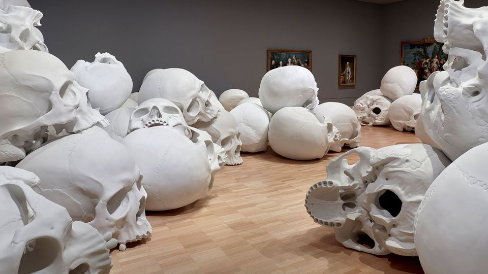 "The NGV scoped out locations around Melbourne where the rest of the skulls could be produced, rather than shipping 100 skulls across the oceans. After the NGV had sourced a fibreglass workshop that could make the skulls, Mueck travelled to Melbourne to work with them on the project.     ""Timing was always going to be a major consideration and it became clear that we would need a separate crew dedicated to cleaning up and finishing the casts as they came out of the fibreglass workshop,"" Mueck says. ""The NGV put together a group of technicians from their pool of art handlers. Initially there were two but this team expanded to about eight people."""