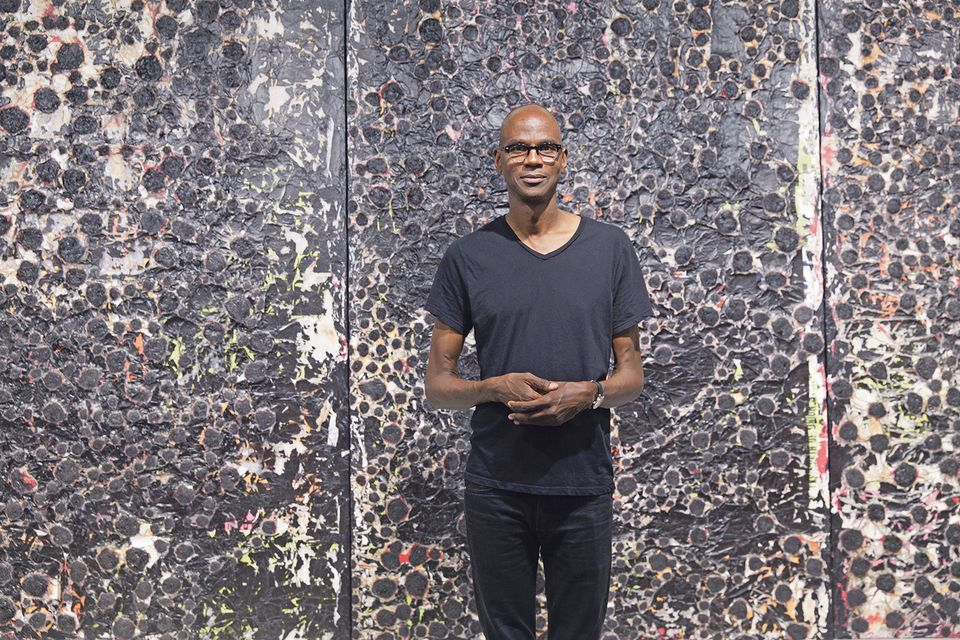 The Los Angeles artist Mark Bradford in front of his work at Hauser & Wirth's stand at Art Basel in Miami Beach