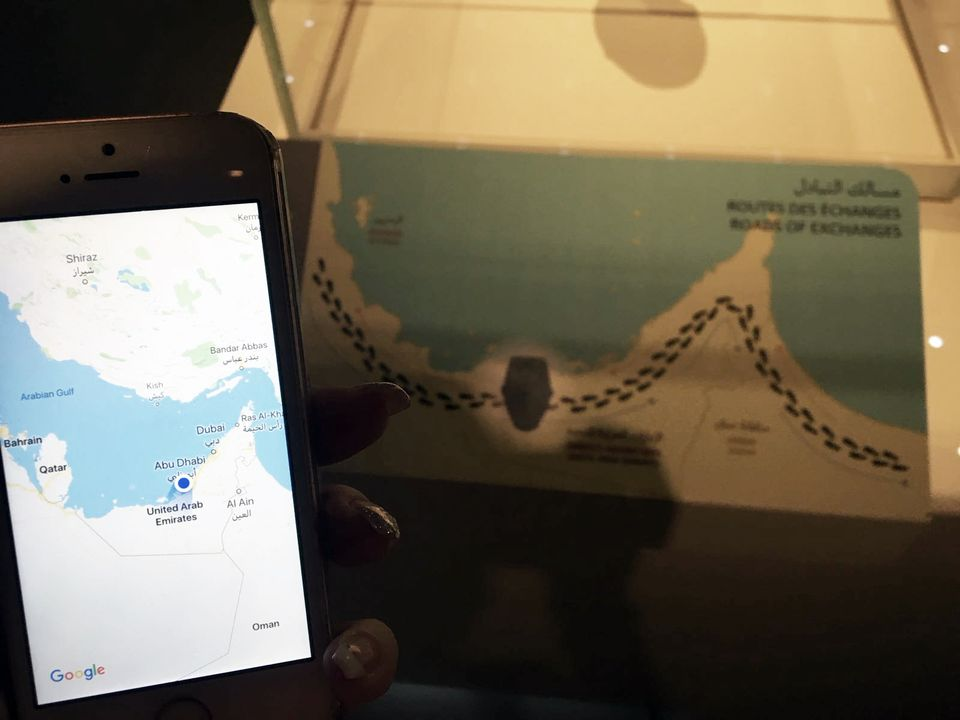The original map at Louvre Abu Dhabi alongside a Google map of the Gulf