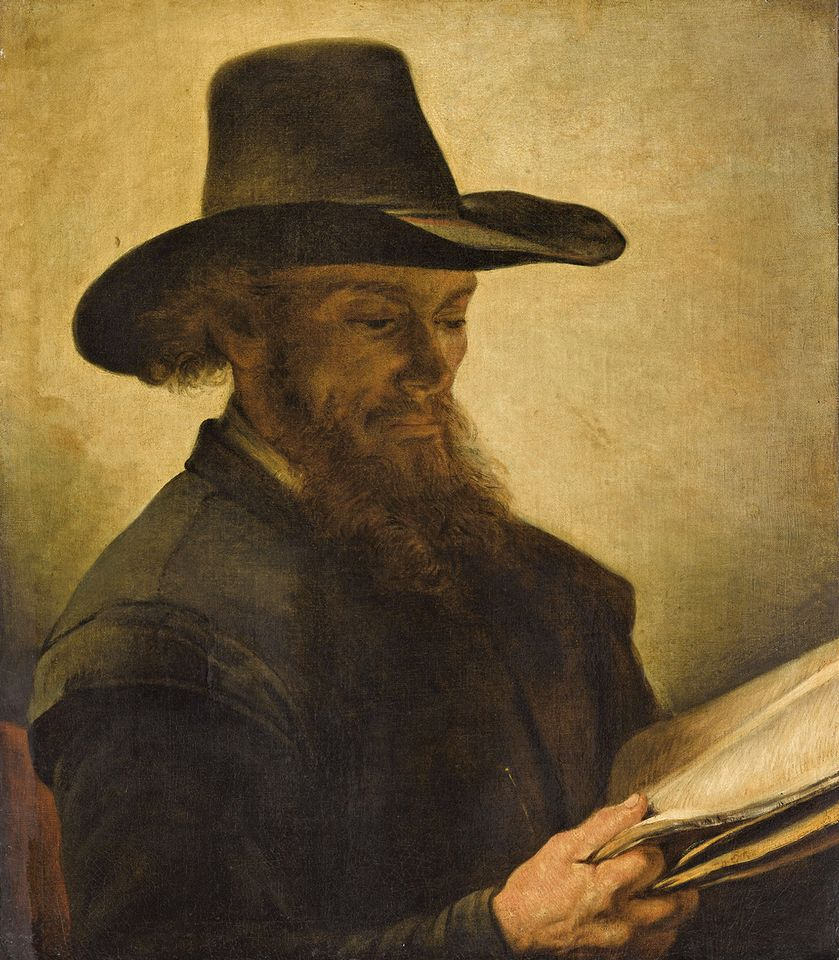 Barent Fabritius's Man Reading (17th century) is one of the looted works on view at the Louvre