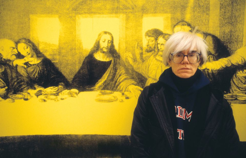 Andy Warhol in front of a version of The Last Supper, in Milan in 1987
