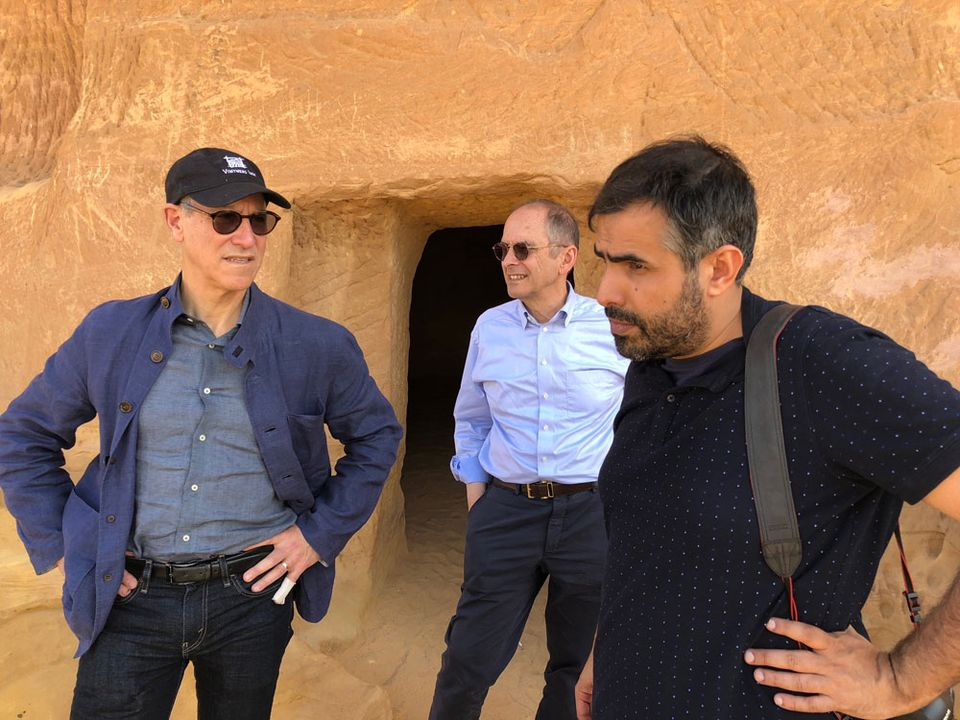Glenn Lowry and Jay Levenson of MoMA with Ahmed Mater, the director of the Misk Art Institute, at the archaeological site of Mada'in Saleh as guests of the Crown Prince in December 2017