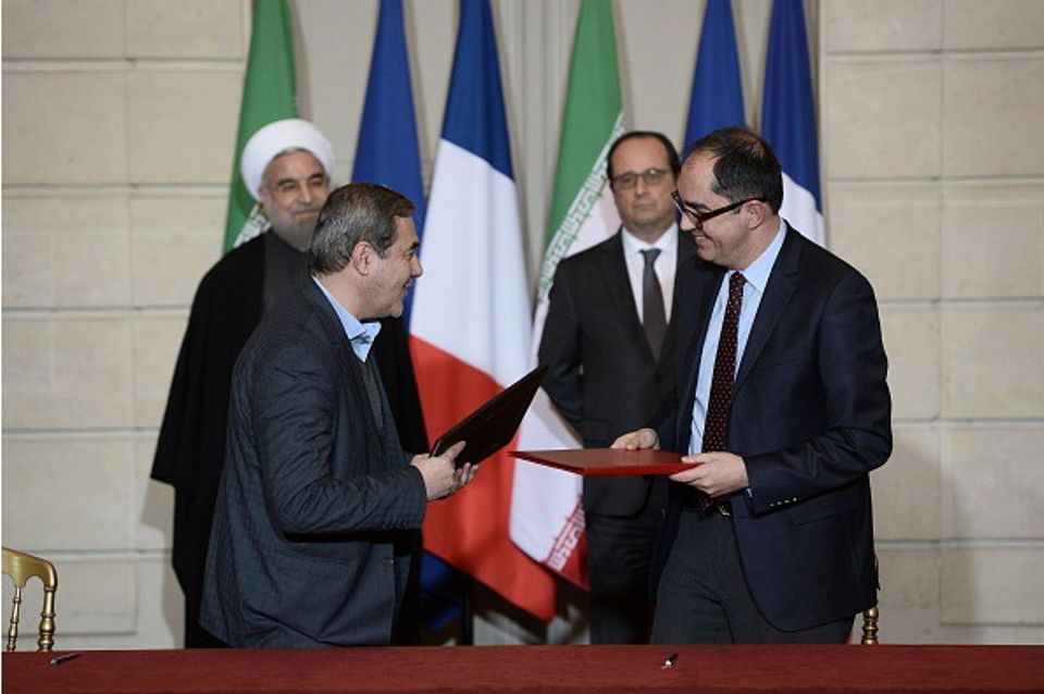 Namvar Motlagh, left, the Vice President of Iran's cultural heritage and tourism organisation, and the Jean-Luc Martinez, the director of the Louvre, signed a cultural cooperation agreement at the presidential palace, with Iranian President Hassan Rouhani