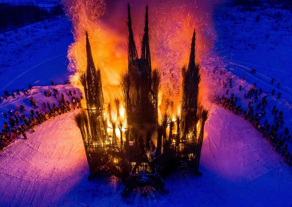 The burning of the 30m Gothic-style structure built of twigs by the Russian artist Nikolay Polissky