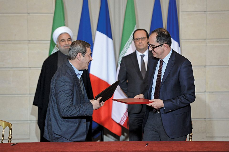 Jean-Luc Martinez (right), the Louvre's director, signed an agreement with the Iranian government in 2016