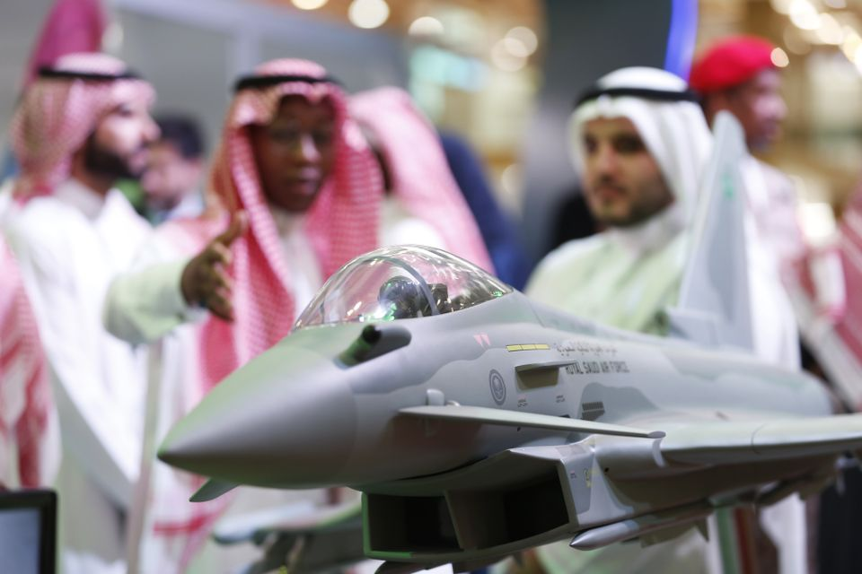 Visitors look at a display model of a Saudi Air Force Eurofighter Typhoon jet, manufactured by BAE Systems Plc, at the Armed Forces Exhibition for Diversity of Requirements and Capabilities (AFED) in Riyadh, Saudi Arabia, on 27 February.