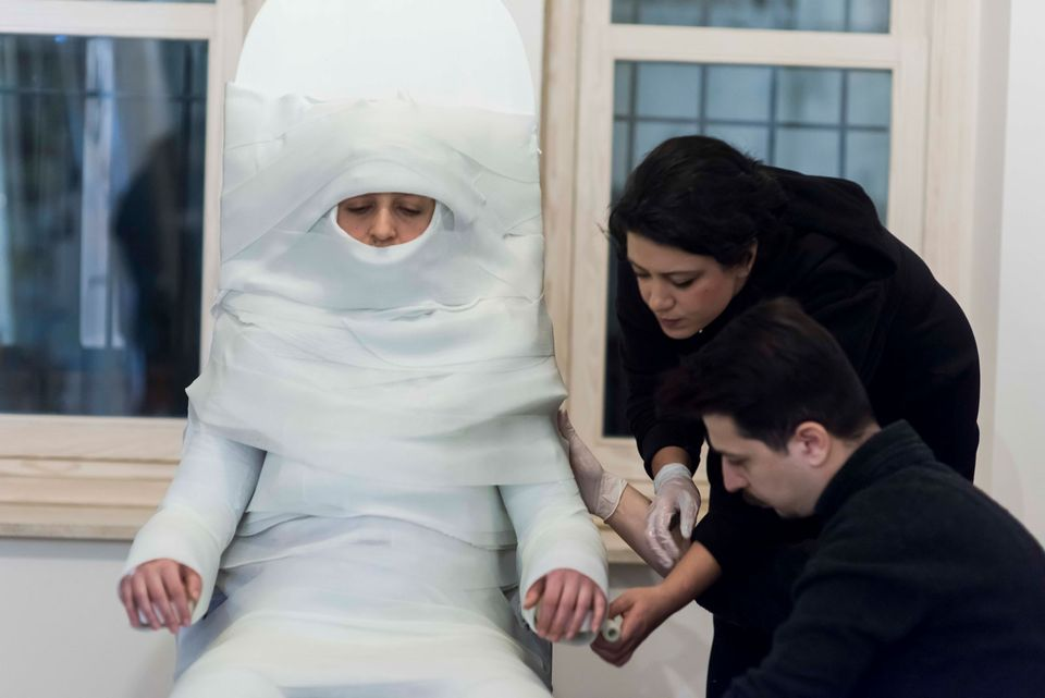 In her performance Kala, Ozlem Unlu is wrapped like a mummy in a plaster cast