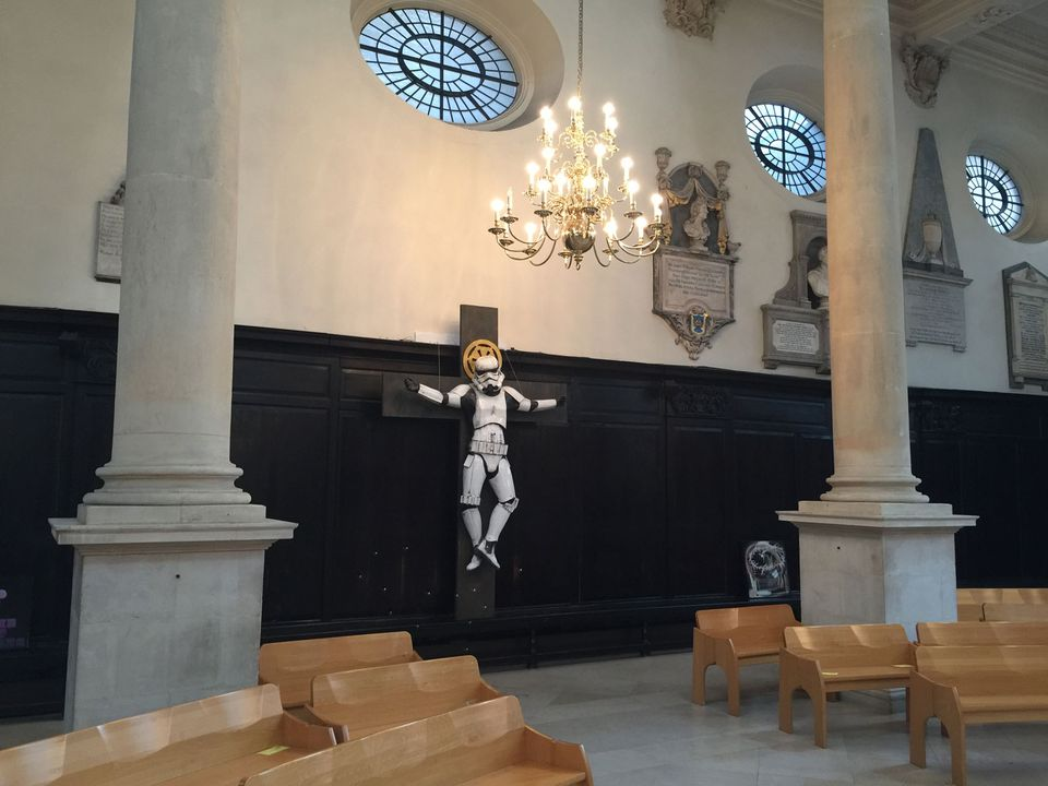 A stormtrooper sits on the cross at St Stephen Walbrook church
