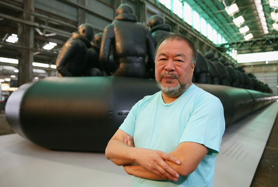 Ai Weiwei poses in front of his work 'Law of the Journey' on March 12, 2018 in Sydney, Australia. The 60m rubber raft installation features over 300 larger than life size figures and is part of the 21st Biennale of Sydney. (Photo by Don Arnold/WireImage