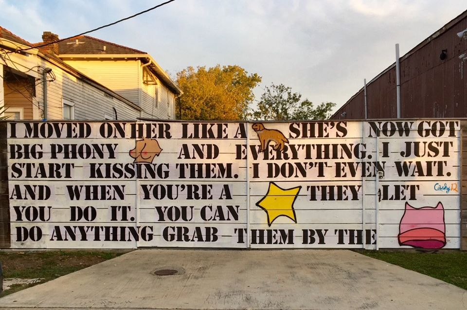 The mural, by the artist Cashy-D, depicts a quote from the 2005 Access Hollywood Tape in which US President Donald Trump brags about grabbing women's genitals with impunity—with select nouns replaced by images