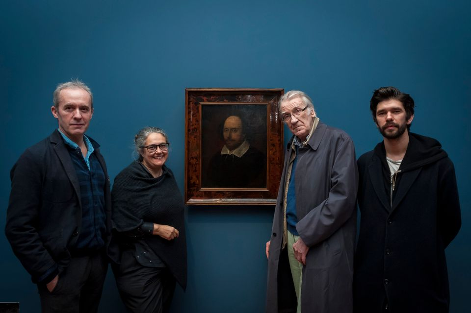 Stephen Dillane, Tacita Dean, David Warner and Ben Whishaw pose by a portrait of Shakespeare during a viewing of  Dean's new film portrait of the actors at the National Portrait Gallery on 13 March