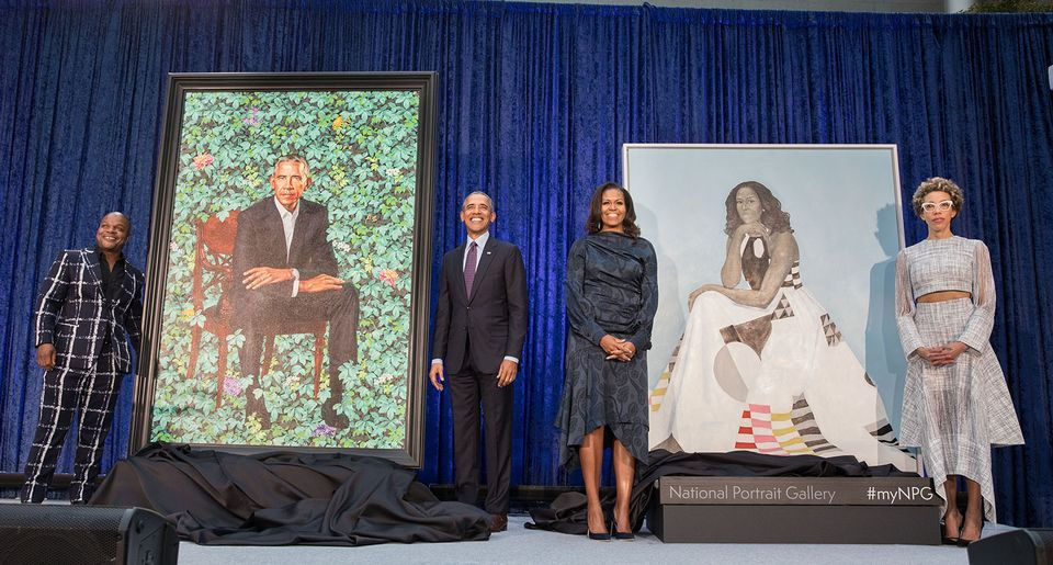 Former President Barack and First Lady Michele Obama (centre) stand with the artists Kehinde Wiley and Amy Sherald in front of their official portraits during a ceremony at the Smithsonian's National Portrait Gallery