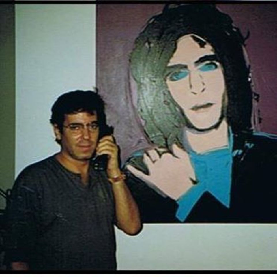 Todd Brassner with a portrait of him by Andy Warhol