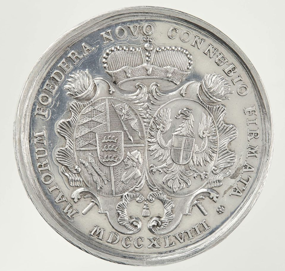 The opera house was first built for the marriage of Margravine Wilhelmine's only daughter Princess Elisabeth Friederike Sophie to Duke Carl Eugen von Württemberg in 1748. opening with a magnificent festival and performances of Italian operas. This is a commemorative silver medal for the occasion, that depicts the coat of arms of the bride and groom.