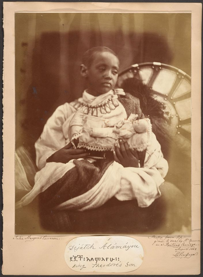Julia Margaret Cameron's photograph of Déjatch Alámayou, the son of King Theodore who committed suicide after the British defeat of the Ethiopians at the battle of Magdala. He was taken to England where Queen Victoria saw to his education and protection. He was buried at Windsor Castle when he died of pleurisy aged 18.