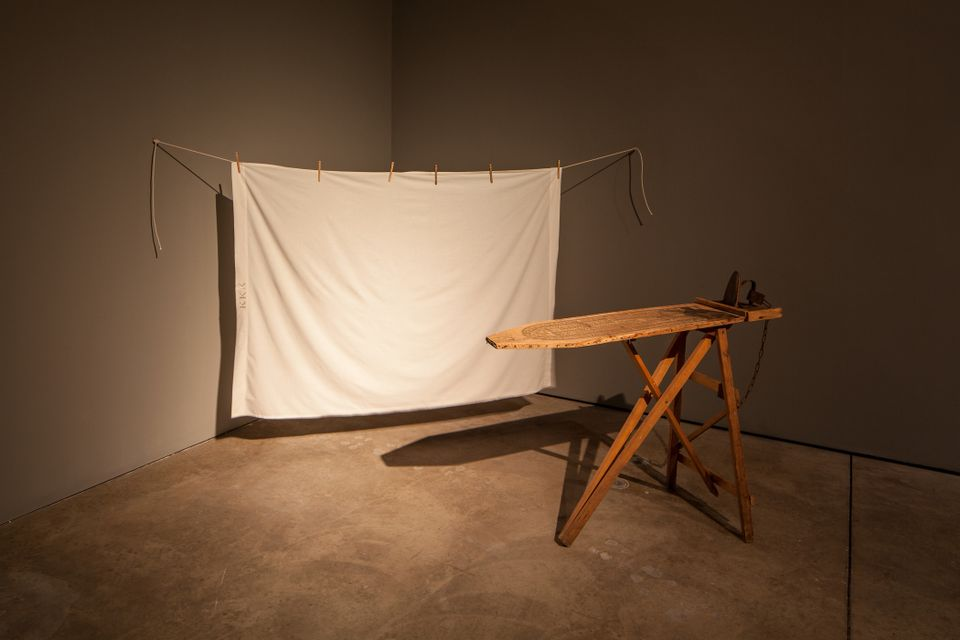 Betye Saar, I'll Bend But I Will Not Break, 1998, mixed media tableau: vintage ironing board, flat iron, chain and white bedsheet installation, 80 x 96 x 36 in., Los Angeles County Museum of Art, gift of Lynda and Stewart Resnick through the 2018 Collectors Committee