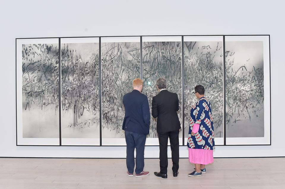 Artist Muna El Fituri, Artist Thomas Houseago and Michael Govan view the Julie Mehretu photogravure
