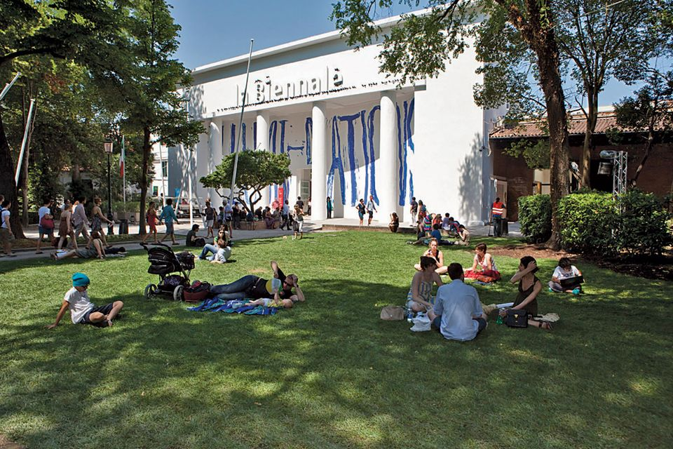 Tourists enjoying the Giardini during the Biennale
