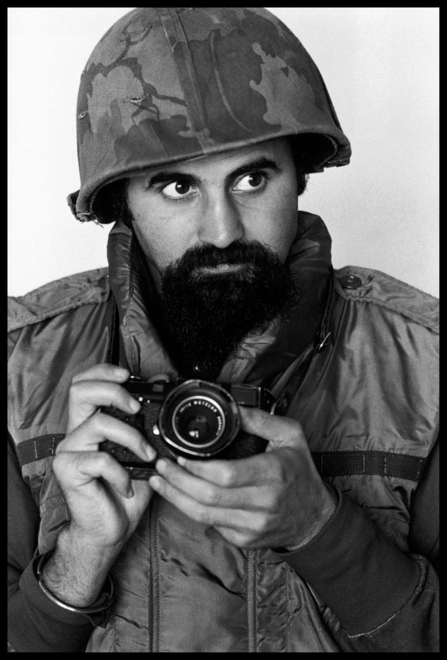 Abbas wears helmet and flack-jacket while covering the war in South Vietnam, 1973
