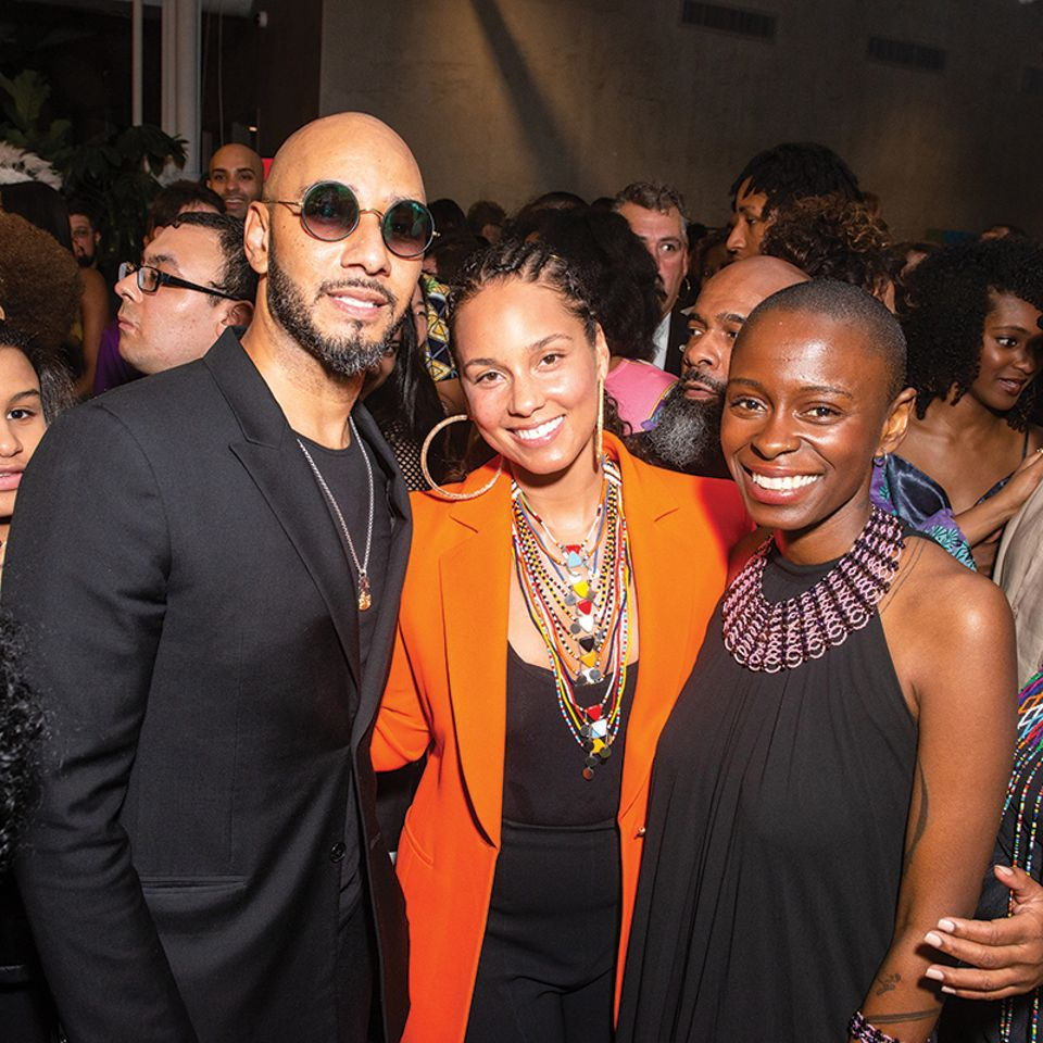 The musical couple Swizz Beatz and Alicia Keys  (left) with  Rees Visionary Award-winning artist Toyin Ojih Odutola