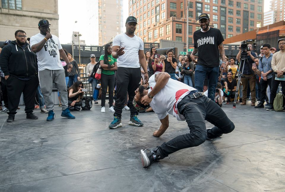 """Flexn"" dancers and educators in The Shed's pre-opening commissioning program, FlexNYC: Reggie 'Reg Roc' Gray (holding mic); Dwayne 'Si Fi' Crichlow (middle in white t-shirt making hand gesture); Steve A. Harvey aka Stickz (right); and Cal Hunt (center dancer on the floor)."