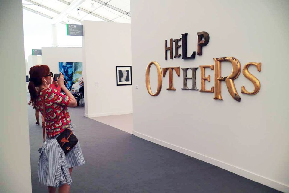 """Jack Pierson, Help Others (2017) at Galerie Thaddaeus Ropac: Referring to the American dream, this is a ready-made work of letters in wood and metal from old movie marquees and commercial signs that the New York-based artist Jack Pierson found across the US. """"Help others: it's much more rewarding than being self-centred all the time,"""" Minter says, drawn in by the message. """"And it's really hard for artists,"""" she adds, with a laugh."""