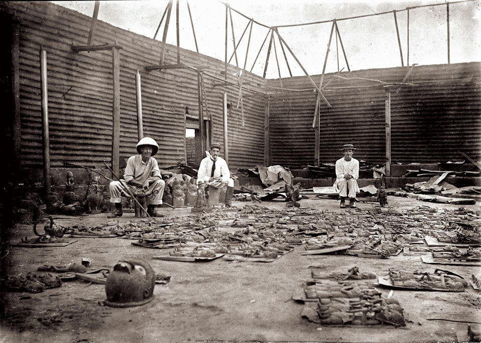 Three British officers with their plunder after the siege of Benin City in 1897. Nigeria has filed restitution claims for the looted objects