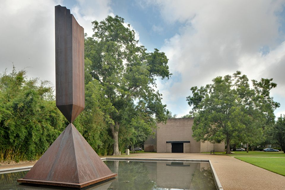Broken Obelisk (1969) by Barnett Newman in the reflecting pool on the grounds of Rothko Chapel in Houston, Texas