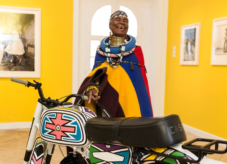Esther Mahlangu with the motorbike she has decorated for the exhibition African Passions, part of the inaugural Evora Africa festival